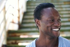 Portrait of a black man laughing and looking away Royalty Free Stock Photography