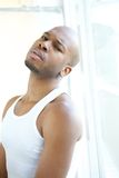 Portrait of a black man relaxing by window Royalty Free Stock Photos