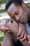 Portrait of a black man resting with eyes closed. Closeup portrait of a black man resting with eyes closed royalty free stock photos