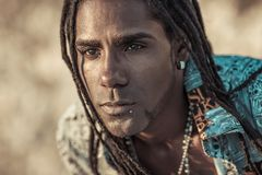 Portrait of black men with dreadlocks in a fancy shirt. Conceptual portrait of black man with dreadlocks Royalty Free Stock Images
