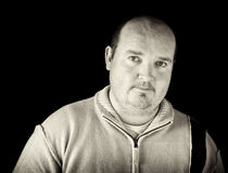 Portrait black white of overweight male on black Royalty Free Stock Photo