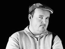 Portrait black white of overweight male on black Royalty Free Stock Photos