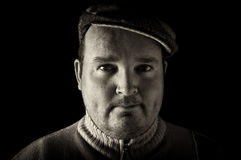 Portrait black white of overweight male on black Royalty Free Stock Images