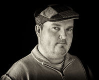 Portrait black white of overweight male on black Stock Photography