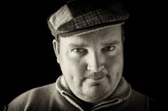 Portrait black white of overweight male on black Stock Photos