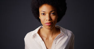 Portrait of black woman with afro and white blouse Stock Photos