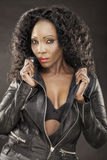 African lady with leather jacket Stock Images