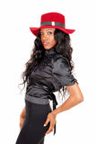 Portrait of black woman with red hat. Stock Photography