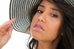 Portrait of black woman in white bikini with straw hat Royalty Free Stock Images