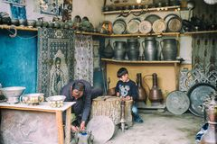 Portrait of Blacksmith and his son from Lahic. Copper production and utensils in Lahiche - the center of handicraft production royalty free stock photo