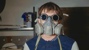 Portrait of blacksmith in protective glasses and respirator looking at camera. Portrait of blacksmith in protective glasses and respirator looking at camera at Stock Images