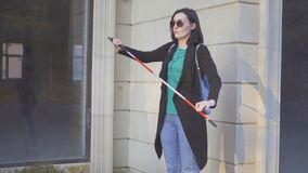 Portrait of a blind girl in glasses with a cane. Close up stock photo