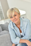 Portrait of blond beautiful senior lady at home Stock Photos
