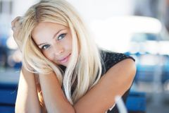 Portrait of a blond beautiful young woman in cafe Royalty Free Stock Images