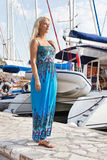 Portrait of blond beautiful young woman at harbor. Royalty Free Stock Photography