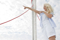 Portrait of blond beautiful young woman on sailing boat. royalty free stock images