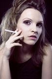 Portrait of blond beauty woman with cigarette Royalty Free Stock Images