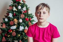 Portrait of a blond boy near a Christmas tree Stock Photo