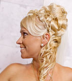 Portrait of blond bride with fashionable coiffure Royalty Free Stock Image