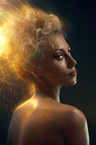 Portrait of a blond with burning hair Royalty Free Stock Photos