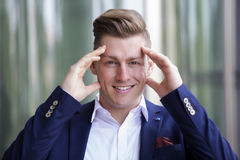 Portrait of  blond businessman smiling at camera Royalty Free Stock Images