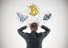 Businessman in panic, cryptocurrency bitcoin Stock Photos