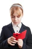 Portrait of blond Caucasian schoolgirl with phone Stock Image