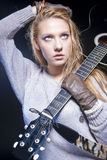 Portrait of Blond Caucasian Woman Posing With Acoustic Guitar Against Black Royalty Free Stock Image