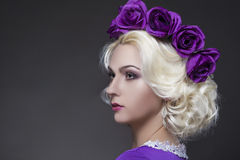 Portrait of Blond Caucasian Woman wearing Violet Flowery Crown Royalty Free Stock Photos
