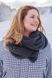 Portrait of a blond chubby woman in winter jacket and thick scarf. Royalty Free Stock Photos