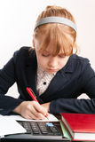 Portrait of blond girl doing homework Royalty Free Stock Image