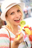 Portrait of blond girl eating fruits Stock Photos