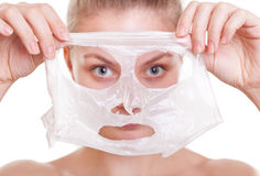 Portrait blond girl in facial mask. Beauty and skin care. Royalty Free Stock Photos
