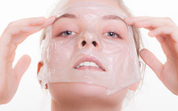 Portrait blond girl in facial mask. Beauty and skin care. Stock Image