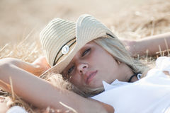 Portrait of blond girl in hat Stock Image