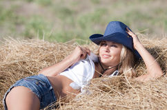 Portrait of blond girl in hat Stock Images