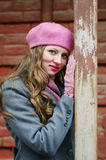 Portrait of a blond girl in a pink beret Royalty Free Stock Photography