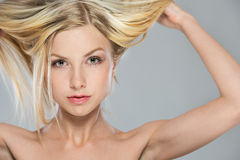 Portrait of blond girl rising up hair Royalty Free Stock Photos