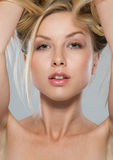Portrait of blond girl rising up hair Stock Photography