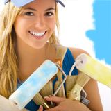Portrait of blond girl smiling. Portrait of blond girl and painting tools Stock Photo