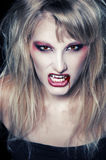 The portrait of a blond girl vampire Royalty Free Stock Photos