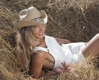 Portrait of blond girl in white dress and hat Stock Photography