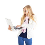 Portrait of a blond girl with a white laptop. Surprising face. Stock Photography