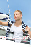 Portrait of blond handsome young man on sailing boat. Royalty Free Stock Photography