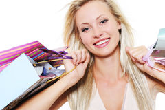 Portrait of a blond happy woman with purchases Royalty Free Stock Photo