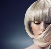 Portrait of a blond lady with trendy coiffure Stock Images