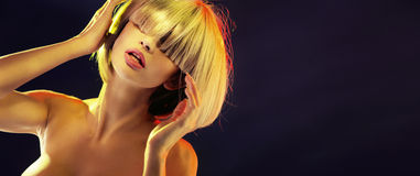 Portrait of a blond lady with a trendy fringe Royalty Free Stock Photography