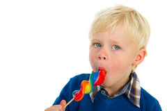 Portrait of a blond little boy eating a lolly Royalty Free Stock Photography