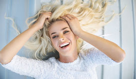 Portrait of a blond lying woman Royalty Free Stock Photography