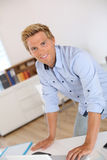 Portrait of blond man standing in office Stock Image